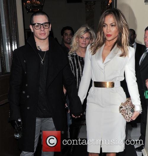 Jennifer Lopez holding hands with her boyfriend Casper...