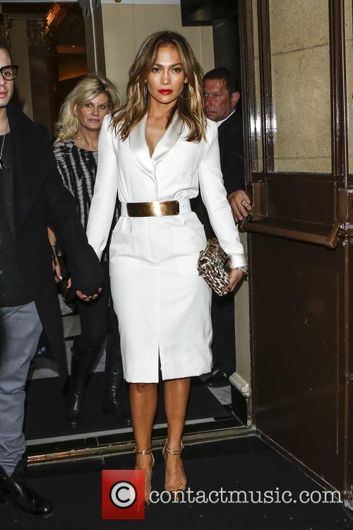 Jennifer Lopez holding hands with her boyfriend Casper Smart as they leave their London hotel