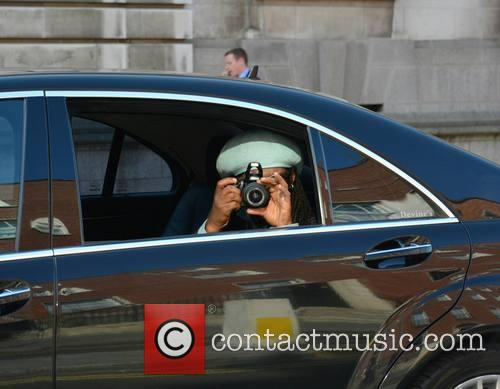 Nile Rogers arrives at his hotel