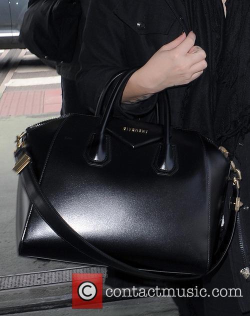 Demi Lovato arrives at London's Heathrow Airport