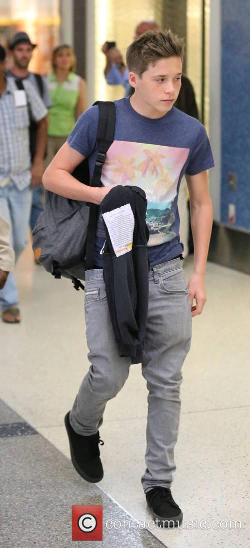 Victoria Beckham arrives at LAX airport with her...