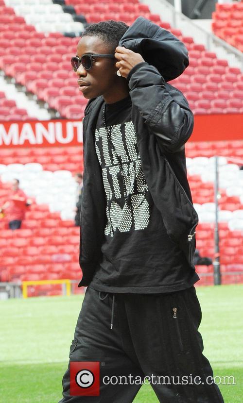 Tinchy Stryder arrives at Old Trafford stadium