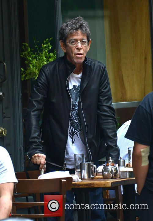 Lou Reed walks with a cane in NYC