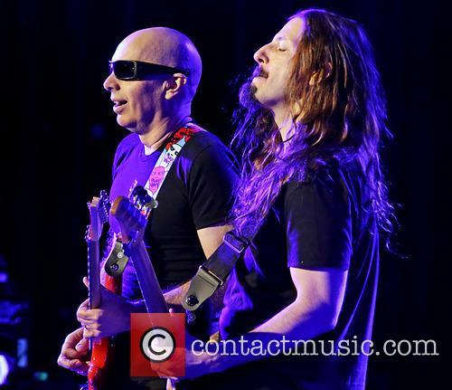 Joe Satriani performing at Manchester O2 Apollo