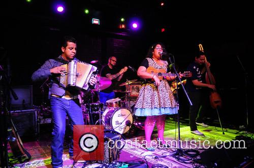 La Santa Cecilia perform during their Latinos Imparables...