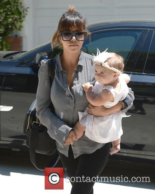 Kourtney Kardashian and Penelope 9