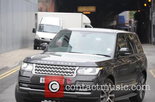 Mark Wright arrives at a Manchester hotel