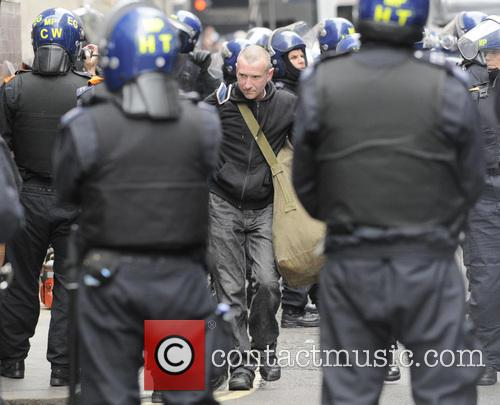 Anti-capitalist demonstrators against the G8 summit are removed...