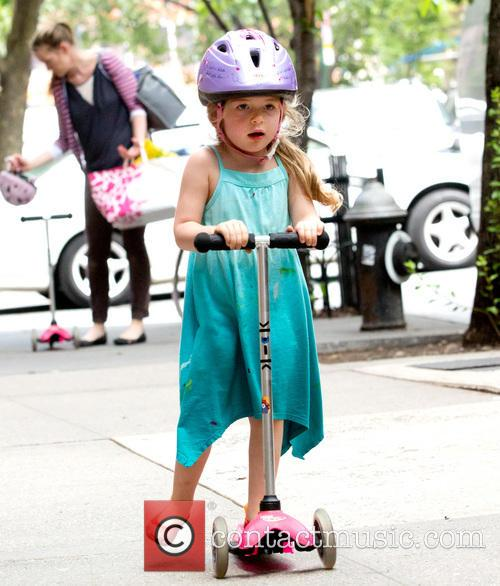 Sarah Jessica Parker picks up her twin daughters...