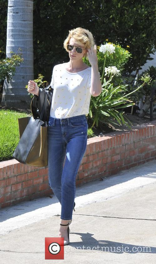 January Jones runs out of her home