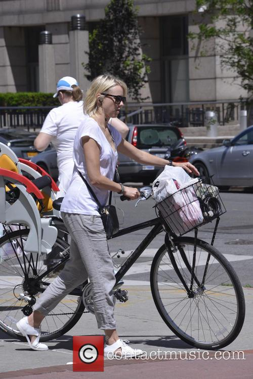 Naomi Watts walks her bicycle through Tribeca