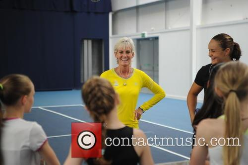 Judy Murray coaches a group of young girls...