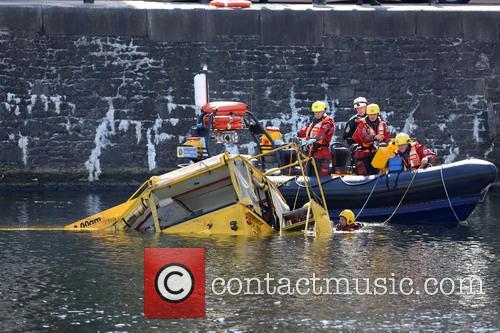 A Duck Marine amphibious tour bus sinks in...