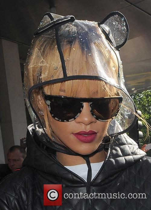 Rihanna leaving her hotel wearing a crazy waterproof...