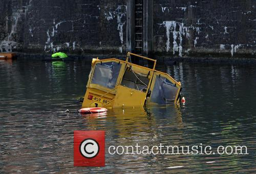 A Duck Marine amphibious tour bus sinks in...
