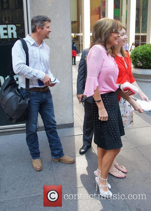 Sarah Palin and her husband outside of Fox...