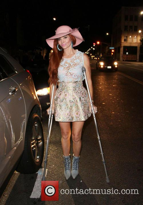 Phoebe Price is seen on crutches as she'...