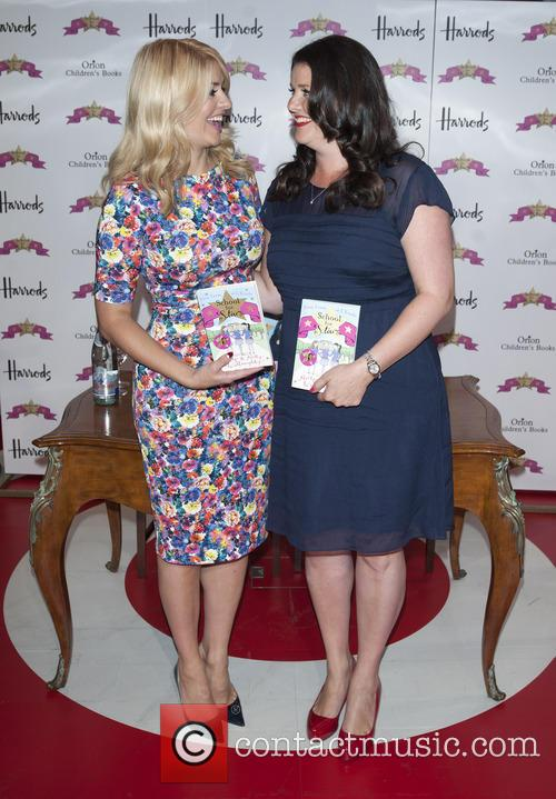 Holly Willoughby and sister Kelly Willoughby sign copies...