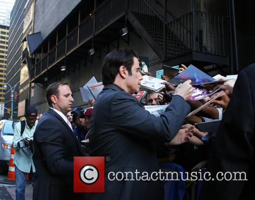 David Letterman and John Travolta With Fans 3