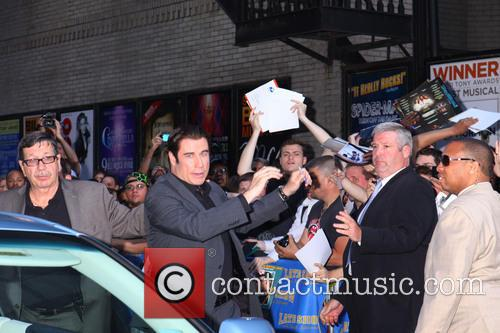 David Letterman and John Travolta With Fans 1