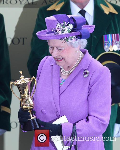 Queen Elizabeth II celebrates winning the Gold Cup...