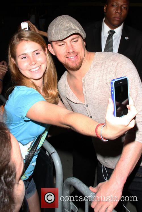Channing Tatum stops to pose for photographs with fans