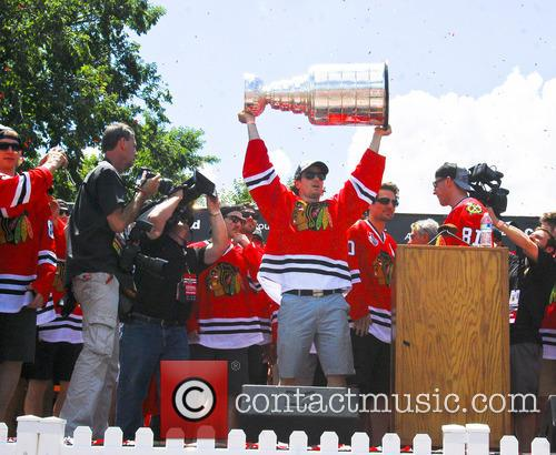 The Chicago Blackhawks celebrate after winning the Stanley...
