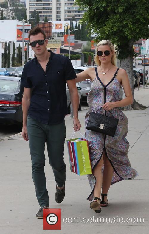A pregnant Jaime King, along with her husband...