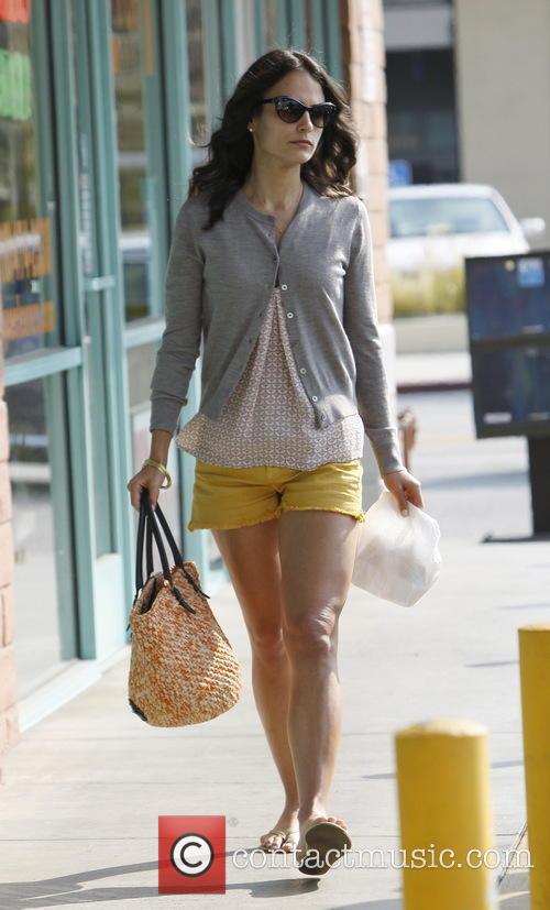 Jordana Brewster running errands wearing yellow shorts