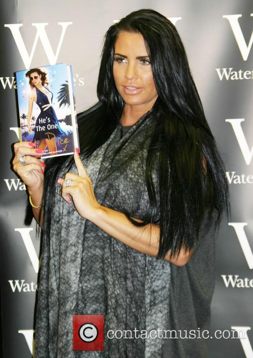 Katie Price signs copies of her new book...