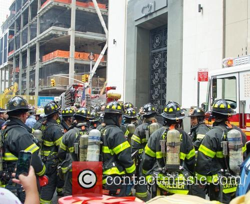 New York City firefighters arrive to put out fire at Century 21 Department store in lower Manhattan