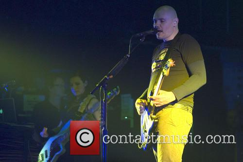 The Smashing Pumpkins, fronted by Billy Corgan, playing...