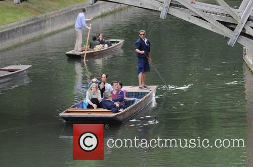 People enjoy the sunny weather while punting along...