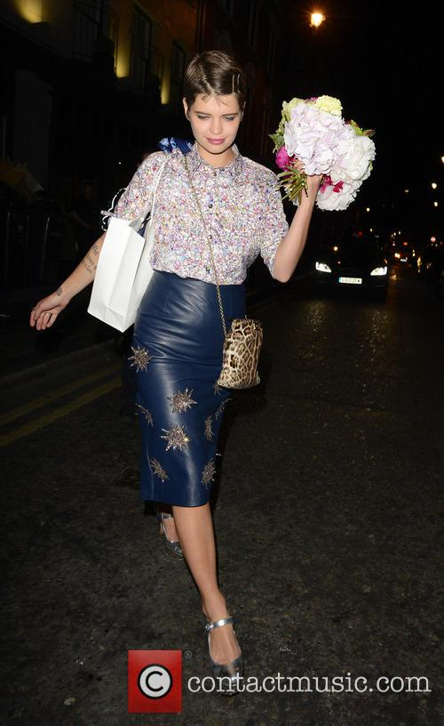 Pixie Geldof holding a bouquet of flowers