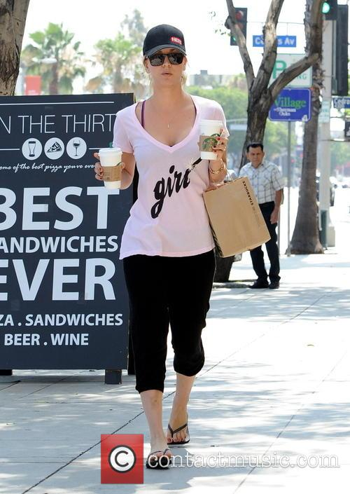 Actress Kaley Cuoco picks up two coffee's at...