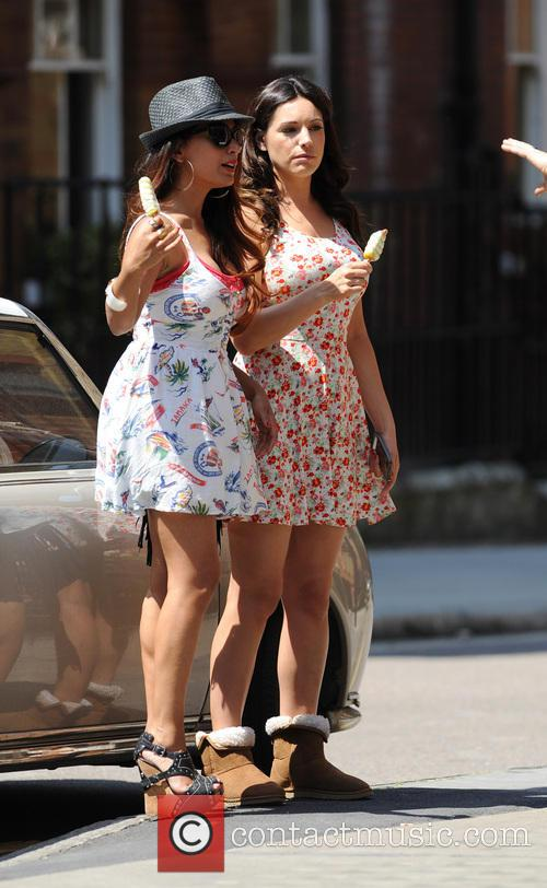 Kelly Brook and a friend  on set...