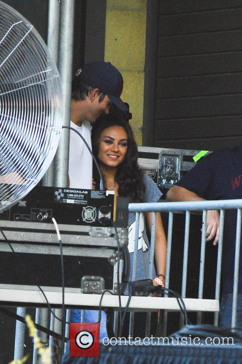 Ashton Kutcher and Mila Kunis at the Taste...
