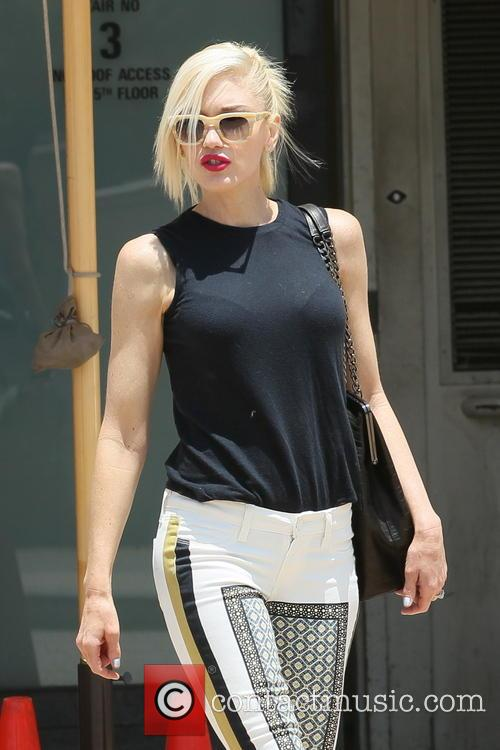 Gwen Stefani leaving Barneys New York with a...