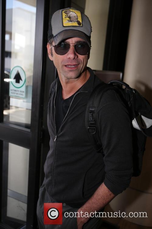 John Stamos arrives at LAX airport