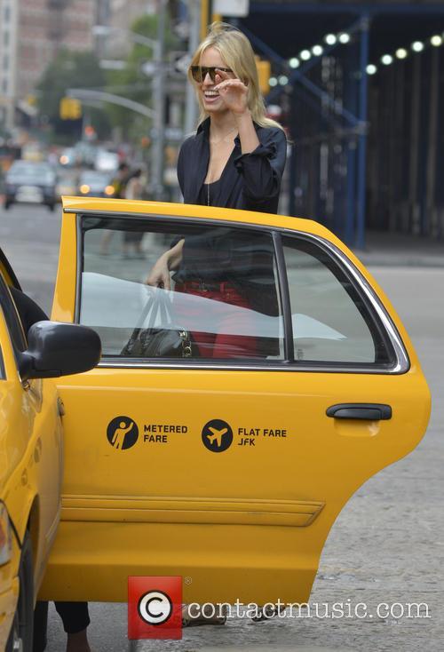 Karolina Kurkova catches a taxi