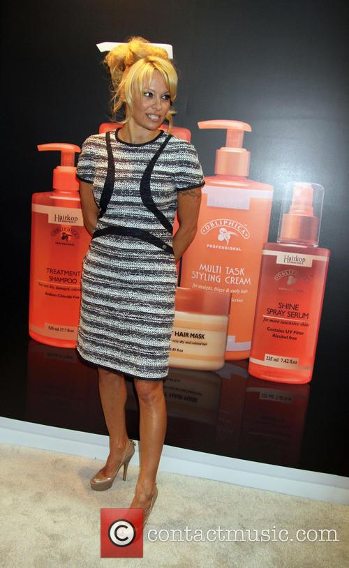 Pamela Anderson at the 'Obliphica' booth during the Cosmoprof Convention