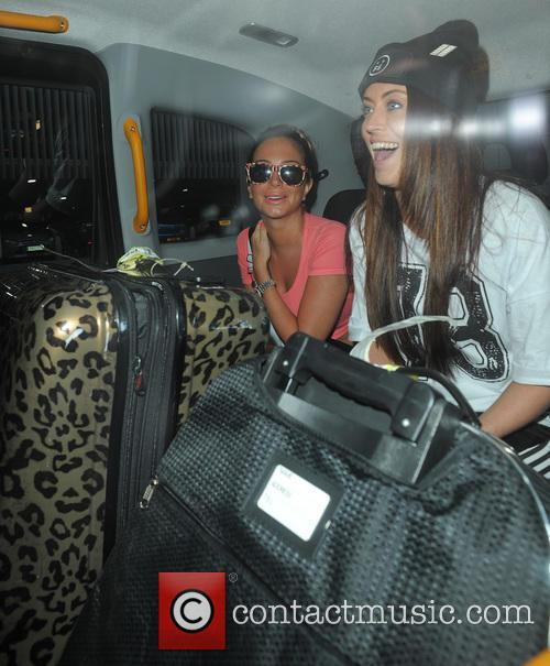 Tulisa Contostavlos arrives at Manchester Airport with a group of friends including Chelsee Healey, after 10 day holiday to the Spaniah Island of Ibiza