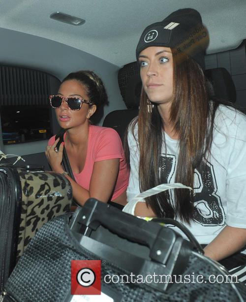 Tulisa Contostavlos arrives at Manchester Airport with a...