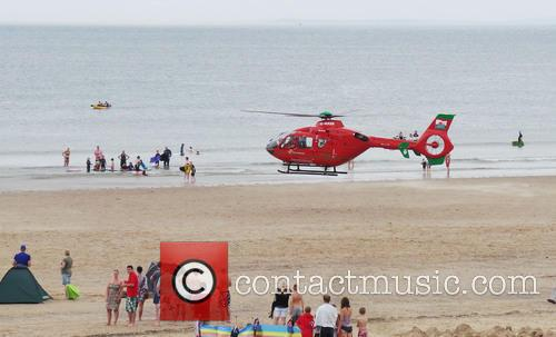 A women fell ill and collapsed on Rhossili...