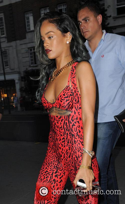 Rihanna spends around 3 hours shopping in Roberto Cavalli on Sloane Street, wearing a red Adidas leopard print jumpsuit