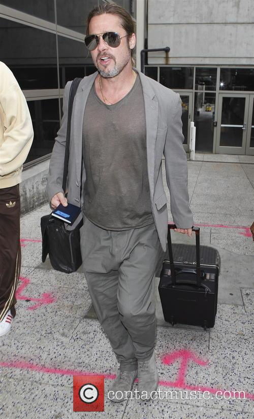 Brad Pitt arrives at LAX airport