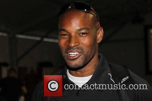 Tyson Beckford visits the US Moto Grand Prix...