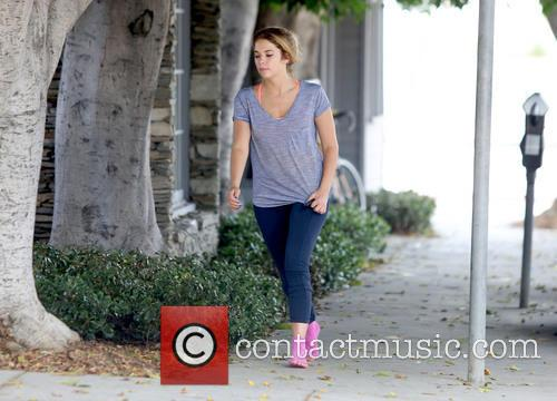 Ashley Benson goes to a gym wearing pink...