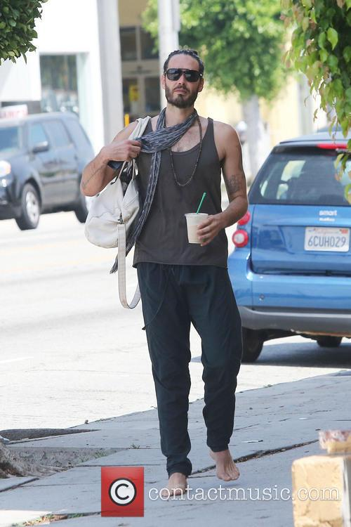 Russell Brand leaving yoga class barefoot
