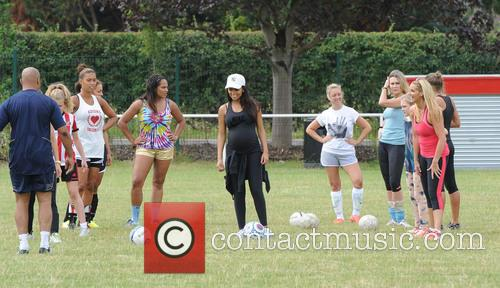 Footballers' wives and girlfriends take part in a...